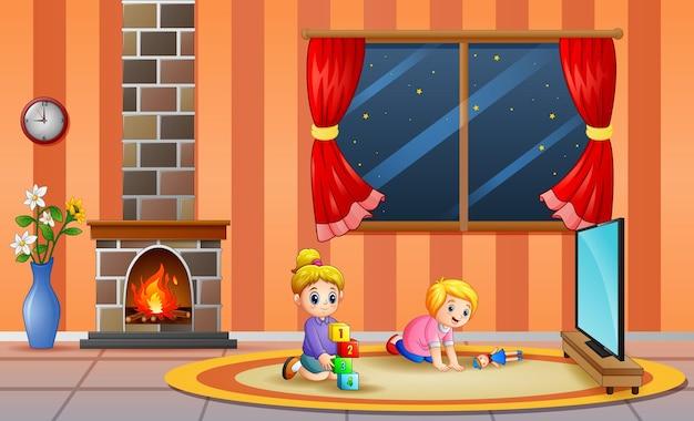 Gelukkig twee meisjes die in de woonkamer spelen