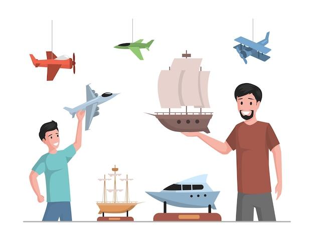 Gelukkig vader en zoon spelen en verzamelen met speelgoedvliegtuigen