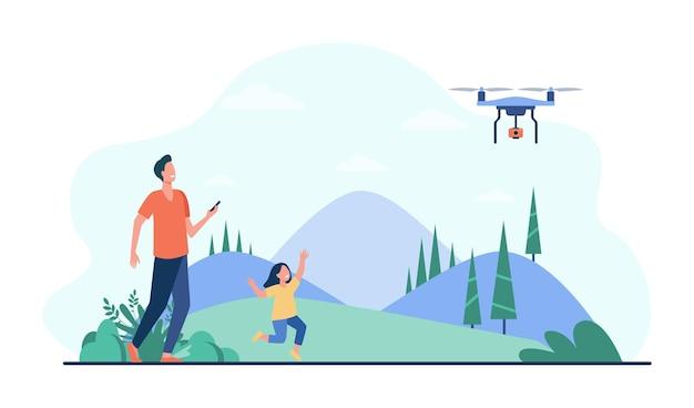 Gelukkig vader met dochter spelen met quadcopter