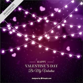 Gelukkig valentijnsdag achtergrond van gloeilampen met hart-vormige