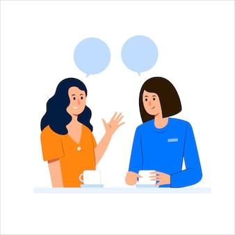 Gelukkig vriendinnen praten terwijl het hebben van koffie
