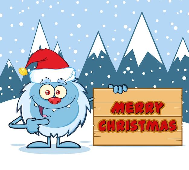 Gelukkig weinig yeti cartoon mascotte karakter met kerstmuts wijzen op een vrolijk kerstfeest