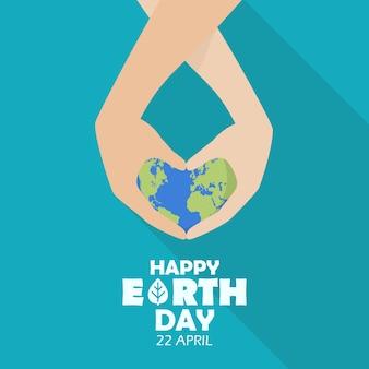 Gelukkige aardedag met handen die aardebol houden