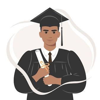 Gelukkige afro-afgestudeerde student met een diploma in afstudeerpet en badjas