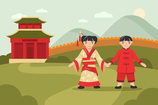 Gelukkige aziatische jongen en meisje in traditionele kleding die samen lopen