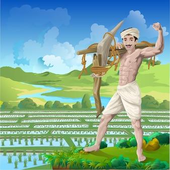 Gelukkige boer staat met vertrouwen op een rijstveld