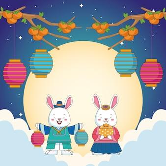 Gelukkige chuseokviering met konijnenpaar en lantaarns die in wolken hangen