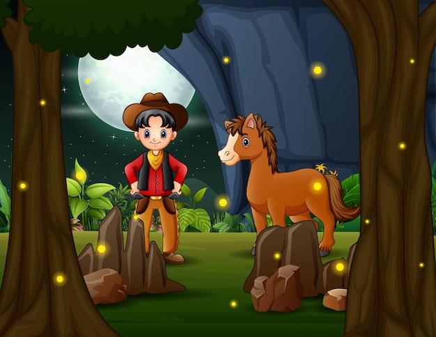 Gelukkige cowboy en een paard in het nachtlandschap
