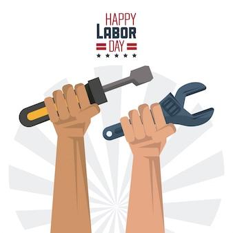 Gelukkige dag van de arbeid met de handen met gereedschap schroevendraaier en sleutel