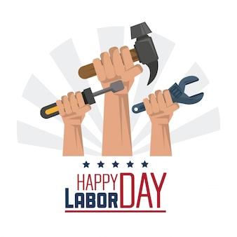 Gelukkige dag van de arbeid met handen met sleutel en hamer en schroevendraaier