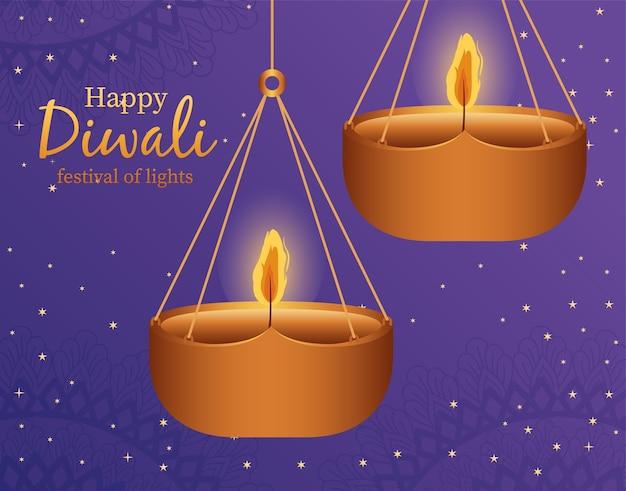 Gelukkige diwali hangende kaarsen op blauw ontwerp als achtergrond, festival van lichtenthema.
