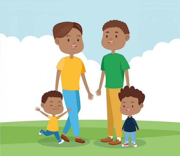Gelukkige familie met hun zonen in het park in het park