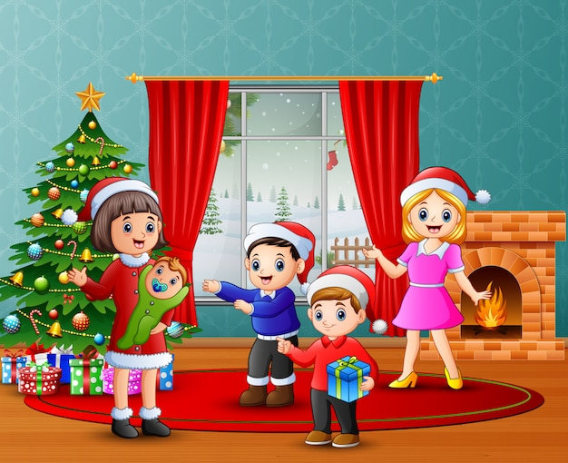 Gelukkige familieviering kerstmis in de woonkamer