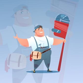 Gelukkige glimlachende werkman die het grote concept van de moersleutel internationale dag van de arbeid houden