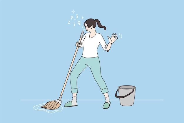 Gelukkige huisvrouw zingt dans in dweil bij het schoonmaken van het huis