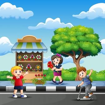 Gelukkige kinderen die naar de bloemenwinkel gaan