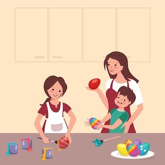 Gelukkige kinderen en moeder schilderen paaseieren aan de tafel in de keuken. jongen en meisje maken decoraties. gezamenlijke familievoorbereiding voor de voorjaarsvakantie. platte vectorillustratie