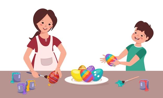 Gelukkige kinderen schilderen paaseieren aan tafel. jongen en meisje maken decoraties voor de vakantie. broer en zus spelen samen. platte vectorillustratie