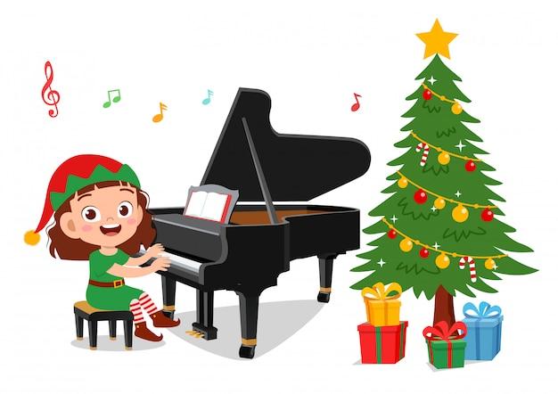 Gelukkige kinderen zingen met piano kerstmis