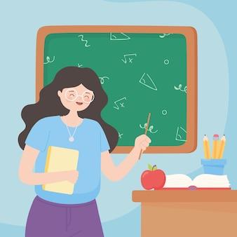 Gelukkige lerarendag, leraar met papieren boekappelpotloden in kop op bureau
