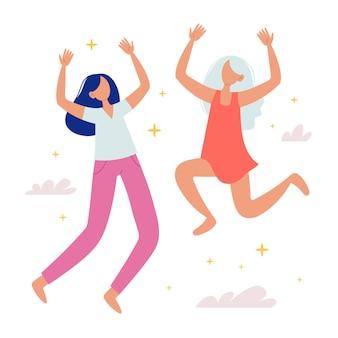 Gelukkige meisjes springen op concept van succes