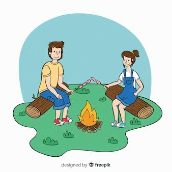 Gelukkige mensen die in aard kamperen