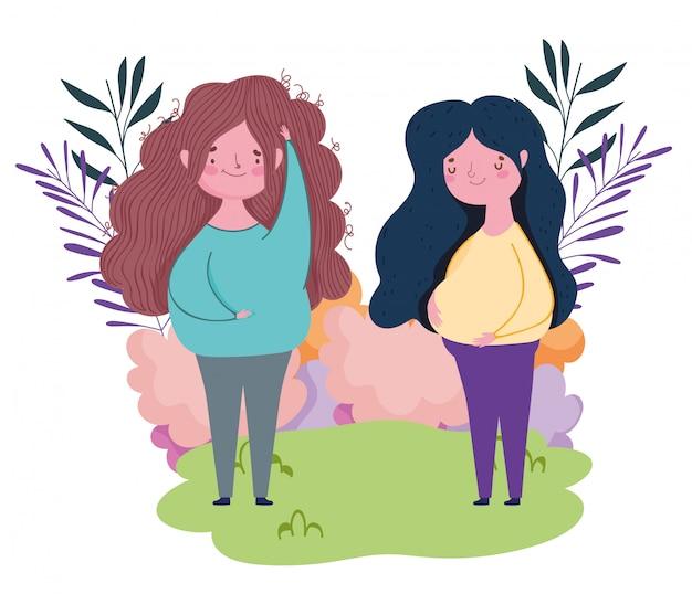 Gelukkige moederdag, zwangere vrouwen samen buiten met gras