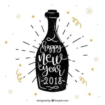 Gelukkige nieuwe jaarhand die op een champagnefles wordt geschreven