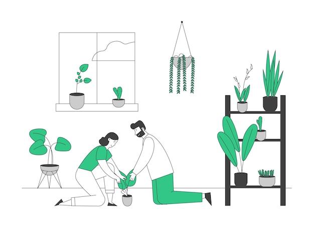 Gelukkige paar verzorging van kamerplanten die groeien in plantenbakken.