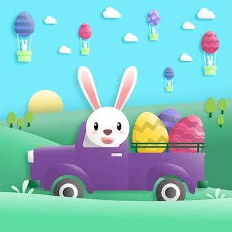 Gelukkige paasdag in papieren kunststijl met konijn en paaseieren