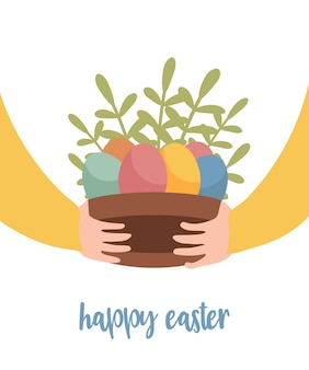Gelukkige pasen-groetkaart met handen die mand verfraaide eieren houden