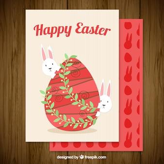 Gelukkige pasen kaart met ei en konijntjes in vintage stijl