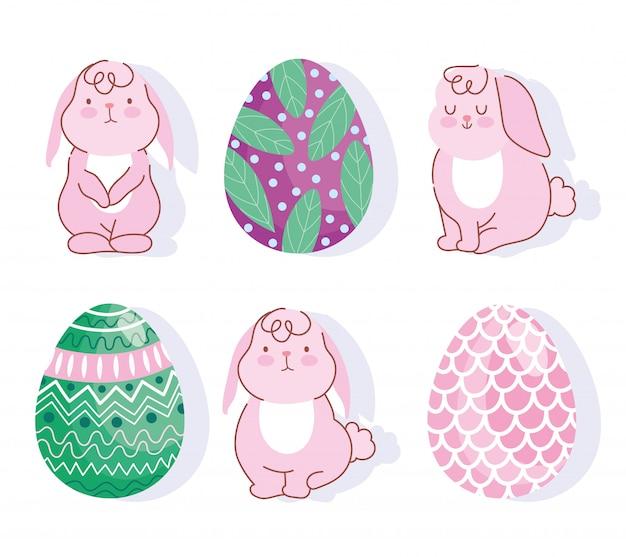 Gelukkige roze de konijntjes en de eierendecoratie van pasen