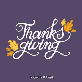 Gelukkige thanksgiving achtergrond met belettering en bladeren