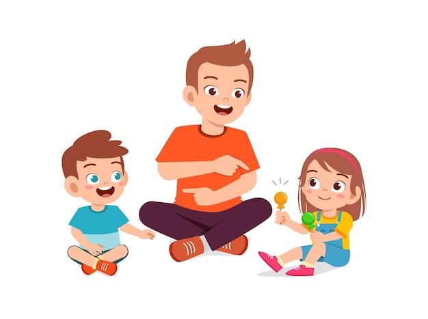 Gelukkige vader geeft snoep en snoep aan zijn jongen en meisje