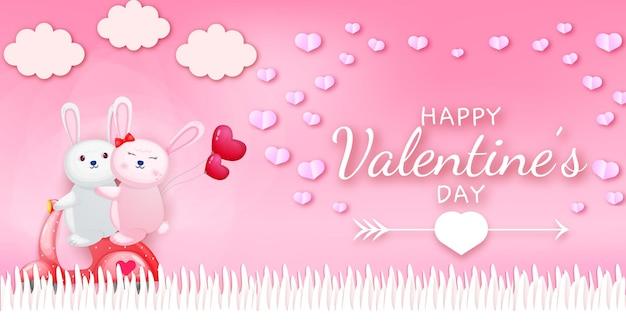 Gelukkige valentijnsdag groet tekst met konijn paar