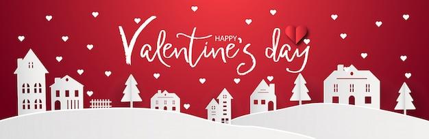 Gelukkige valentijnsdag met dorp van de huis het zoete geboortestad en sneeuwachtergrond