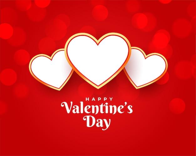 Gelukkige valentijnskaarten die met drie harten begroeten