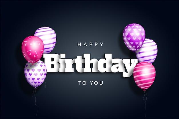 Gelukkige verjaardag achtergrond met realistische ballonnen en papier gesneden teksteffect