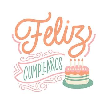 Gelukkige verjaardag belettering in het spaans met cake