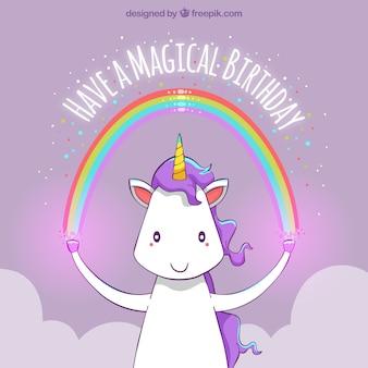 Gelukkige verjaardag eenhoorn achtergrond met een regenboog