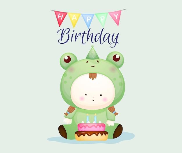 Gelukkige verjaardag met schattige baby in kikkerkostuum. mascotte cartoon afbeelding premium vector