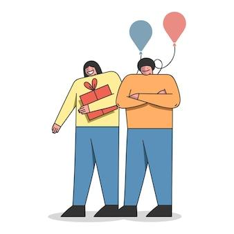Gelukkige verjaardag viering paar met geschenkdoos en ballonnen