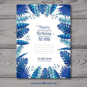 Gelukkige verjaardagskaart met blauwe bladeren in vlakke stijl