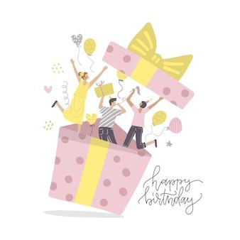 Gelukkige vrienden maken verrassing voor mensen van de verjaardagsfeestje springen uit geschenkdoos