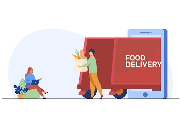 Gelukkige vrouw die voedsel online bestellen