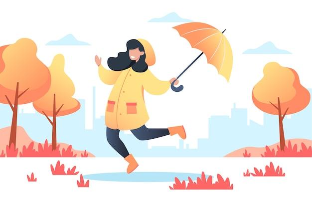 Gelukkige vrouw in een gele regenjas met een paraplu in haar handen loopt in het herfstpark