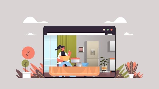 Gelukkige vrouw voorbereiding zoete cake thuis online koken concept moderne keuken interieur web browservenster horizontaal portret