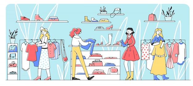 Gelukkige vrouwelijke klanten die kleren kiezen bij manieropslag