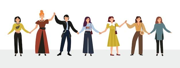Gelukkige vrouwen of meisjes die samen staan en elkaars hand vasthouden. groep vrouwelijke vrienden, vakbond van feministen, zusterschap. platte stripfiguren geïsoleerd op een witte achtergrond. kleurrijke vectorillustratie.